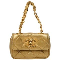 Chanel gold leather minaudièr handbag