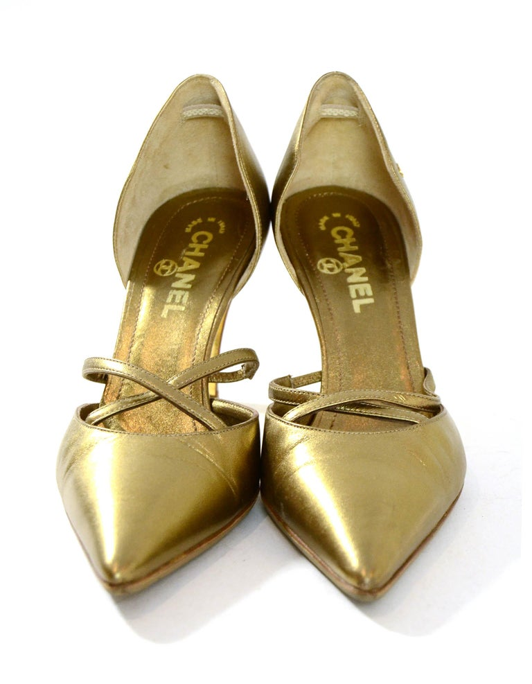 """Chanel Gold Leather Pointy Toe Pumps  Made In: Italy Color: Gold Materials: Leather Closure/Opening: Slip on Overall Condition: Very - slight scuffing throughout  Marked Size: 37.5  Heel Height: 3.5"""""""