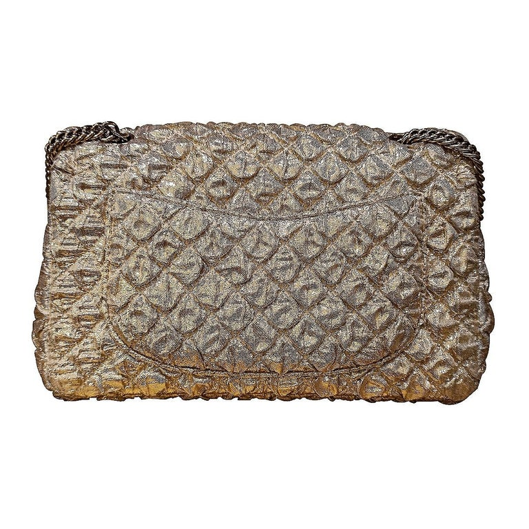 Fantastic and iconic Chanel bag  Year 2006/2008 Limited edition Lamé Golden color Golden hardware With card and serial number inside Cm 23 x 14 x 6 (9 x 5.5 x 2.36 inches) With dustbag  Worldwide express shipping included in the price !
