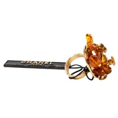 Chanel Gold Metal Adjustable Logo Ring with Amber Resin