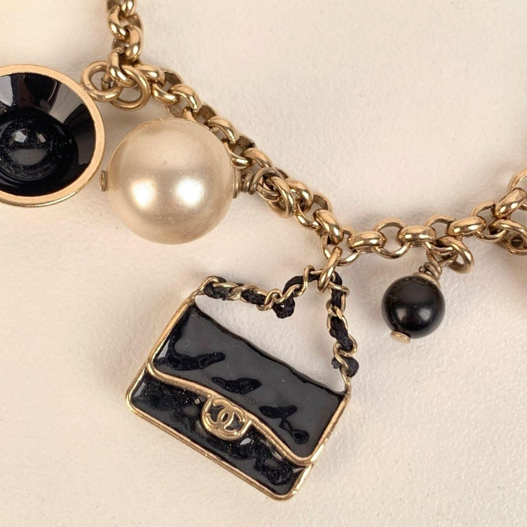 Chanel Gold Metal Faux Pearl and Iconic Charm Bracelet In Excellent Condition In Rome, Rome