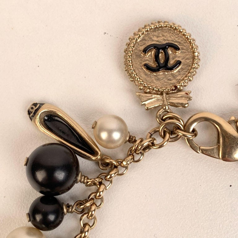 Women's Chanel Gold Metal Faux Pearl and Iconic Charm Bracelet