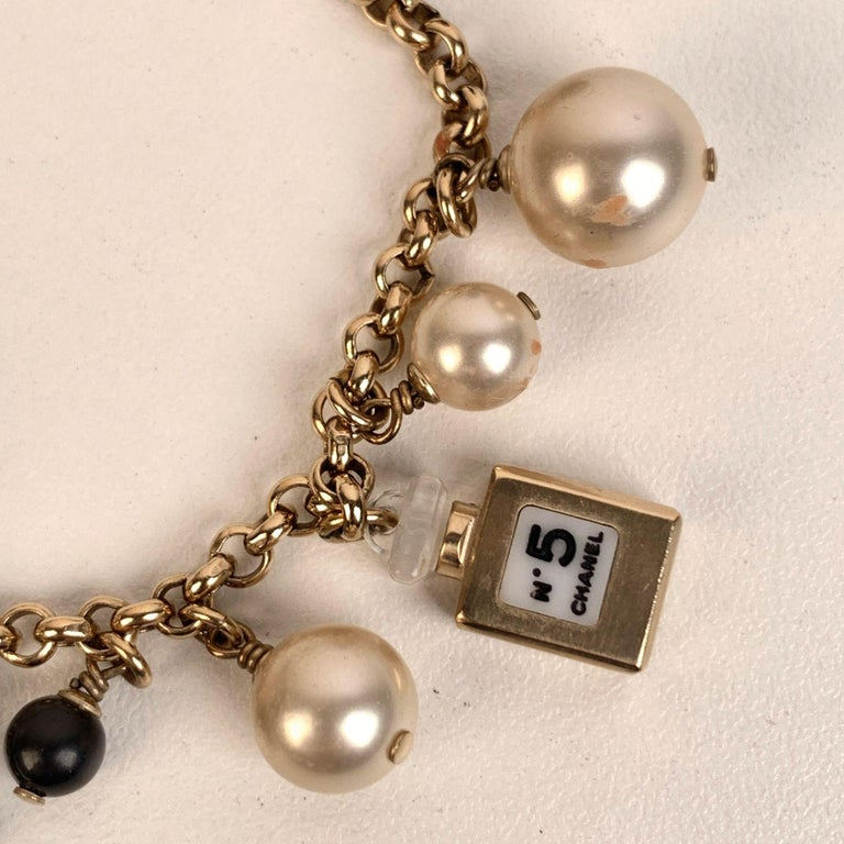 Chanel Gold Metal Faux Pearl and Iconic Charm Bracelet 1