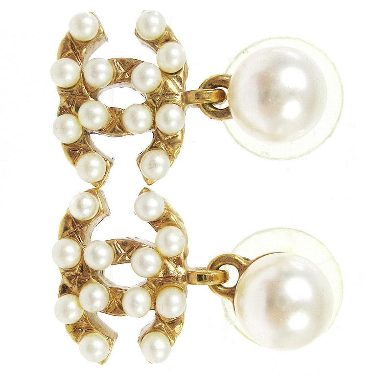 Chanel Gold Pearl Charm CC Small Pierced Evening Dangle Drop Earrings  Faux Pearl Metal Gold tone hardware For Pierced Ears Made in France Measures 0.50