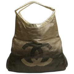CHANEL Gold Perforated Leather Bag