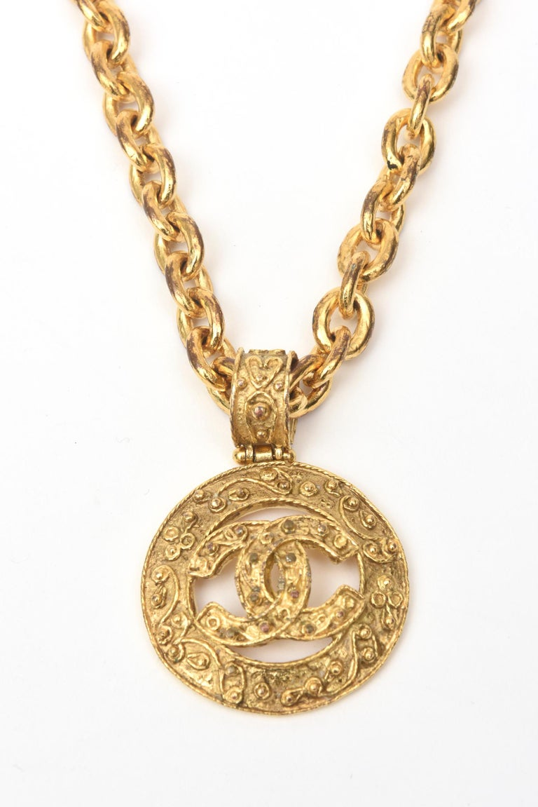 This authentic fabulous Chanel chunky gold plated hammered medallion chain necklace has the interlocking CC's. It is from the 1984. It is hallmarked Chanel