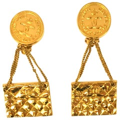 """Chanel Gold-Plated clip on dangle earrings with """"Chanel 51 Rue Cambon Paris"""""""