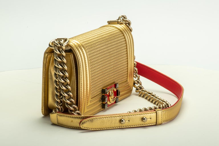 Chanel mint condition small gold boy bag with red details. Shoulder drop, 11