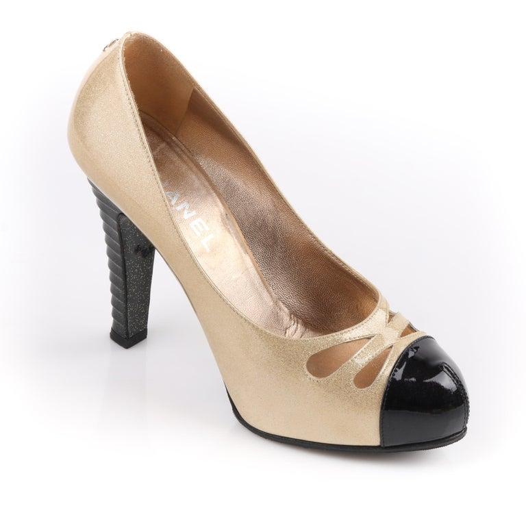 d2cd5bdd17 DESCRIPTION: CHANEL Gold Sparkle & Black Patent Leather Cut Out Cap Toe  Platform Heels Pumps