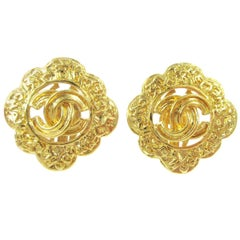 Chanel Gold Textured 'CHANEL' Charm Starburst Stud Evening Earrings in Box
