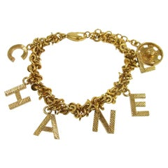 Chanel Gold TexturedMetal Chain 'CHANEL' Charm Word Logo Evening Bracelet