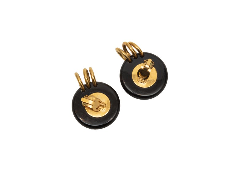 Product Details: Vintage gold-tone, black and faux pearl clip-on earrings by Chanel. Circa 1980s. 1.5