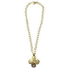 Chanel Gold Tone CC Logo Swirl Cross Necklace