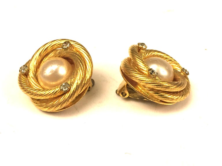 - Vintage gold toned pearl/rhinestones clip on earrings.   -Measurement: 2.5 diameter.   - Collection 29 is Made in between 1984-1990.   - Please note that this vintage item is not new, so it might have minor imperfection.
