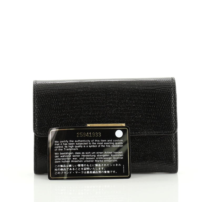 This Chanel Golden Class Wallet Lizard Small, crafted in genuine black and multicolor lizard, features gold-tone hardware. Its CC flip clasp closure opens to a black leather interior with zip pocket and multiple card slots. Hologram sticker reads: