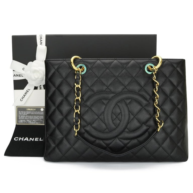 CHANEL Grand Shopping Tote (GST) Black Caviar with Gold Hardware 2011.  This bag is in excellent condition, the bag still holds its shape quite well, and the hardware is still shiny.  Exterior Condition: Mint condition, corners show no visible signs
