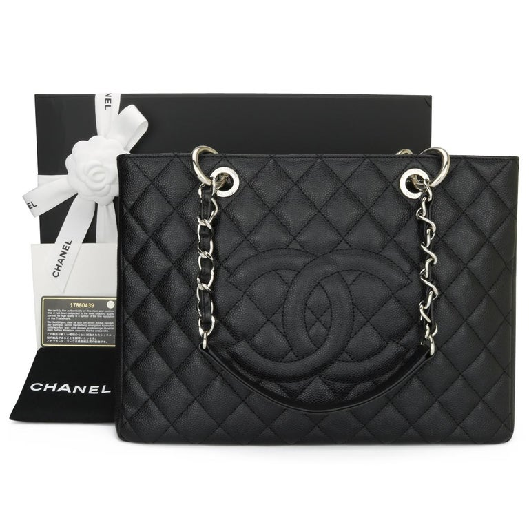 CHANEL Grand Shopping Tote (GST) Black Caviar with Silver Hardware 2013.  This bag is in pristine condition, the bag still holds its original shape, and the hardware is still very shiny.  As Chanel has discontinued the Grand Shopping Tote (GST), it