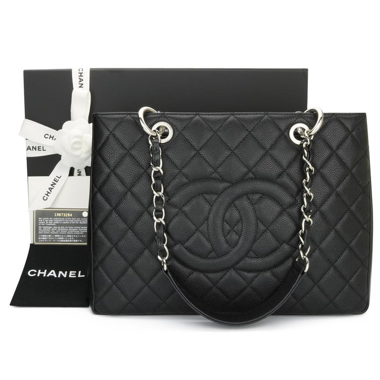 CHANEL Grand Shopping Tote (GST) Bag Black Caviar with Silver Hardware 2014.  This bag is in pristine condition, the bag still holds its original shape, and the hardware is still shiny.  Exterior Condition: Mint condition, corners show no visible