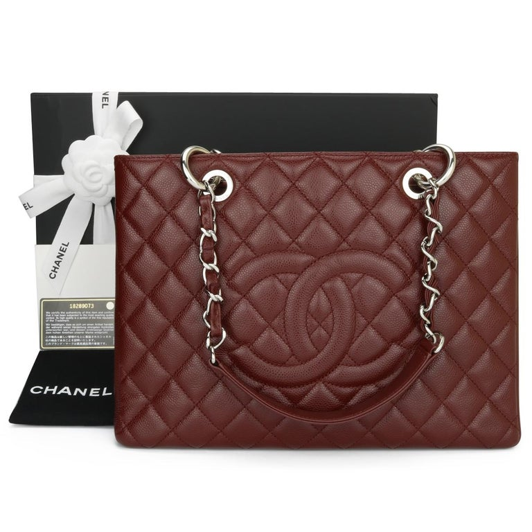 CHANEL Grand Shopping Tote (GST) Burgundy Caviar with Silver Hardware 2014.  This bag is in excellent condition, the bag still holds its original shape, and the hardware is still very shiny.  As Chanel has discontinued the Grand Shopping Tote (GST),