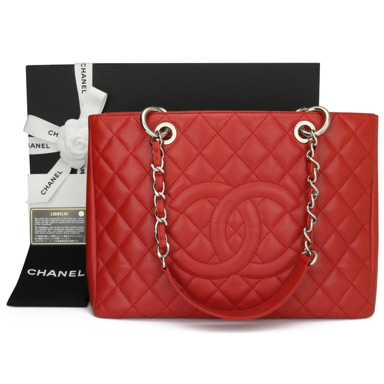 Authentic CHANEL Grand Shopping Tote (GST) Red Caviar with Silver Hardware 2011.  This bag is in excellent condition, the bag still holds its shape very well, and the hardware is still shiny.  Exterior Condition: Excellent condition, corners show