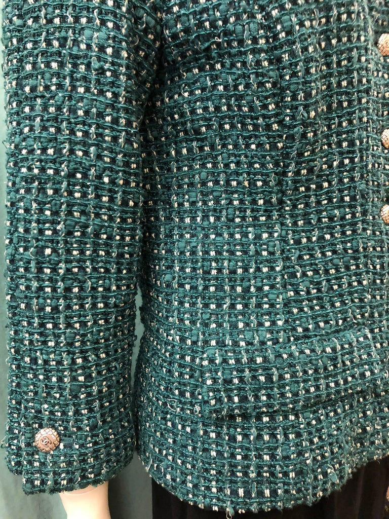 - Chanel green, white , black tweed jacket from 2006 cruise collection.   - 3/4 length sleeves.   - Silver buttons hardware closure.   - Two front pockets.   - Green silk