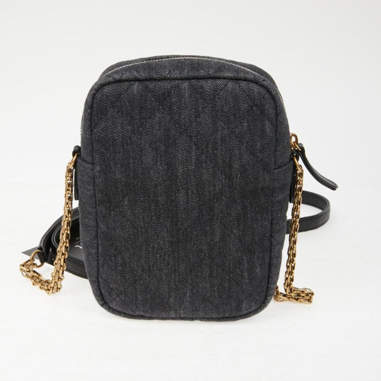 CHANEL Grey Denim Fabric Wallet Shoulder Bag with a 2.55 buckle.  It comes from Chanel private sales.  It can be worn over the shoulder or crossed. Extremely practical for storing your laptop or your credit cards. It is lined in fabric with a slit