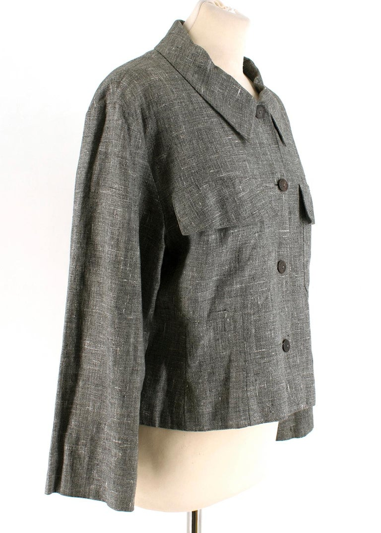 Grey Button up Chanel Blazer   Two pockets on either side of the bust  Four Chanel branded buttons  Quarter Length Sleeves   Light Weight  Elasticated Back  Straight Fit  Made in France   Please note, these items are pre-owned and may show signs