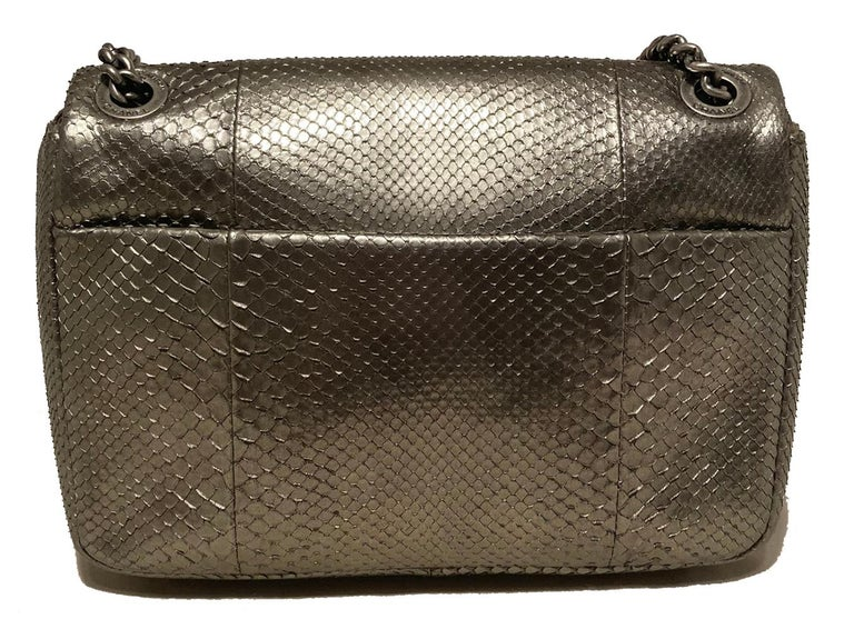 Chanel Grey Metallic Python Shanghai Flap Bag in very good condition. Grey metallic python exterior trimmed with antiqued silver hardware. Silver chain shoulder strap with matching python leather center can be worn short (doubled) or long (single).
