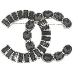 Chanel Grey Rhinestone Logo Pin