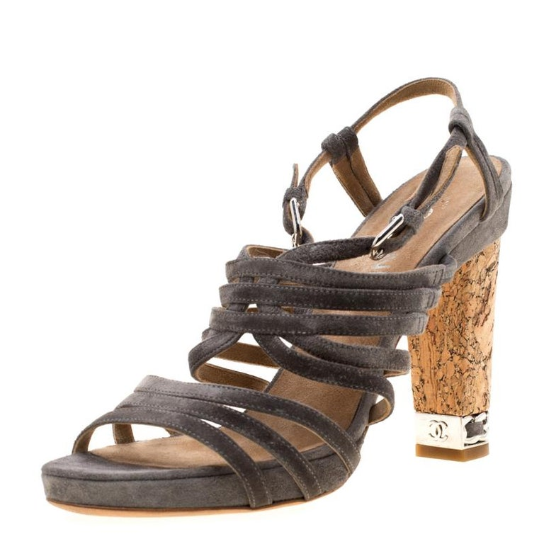 Flaunt style at its best with these beautiful strappy sandals crafted from suede. They feature open toes, buckled ankle straps and block heels which are detailed with signature interwoven chain links. These sandals from Chanel will lend a stylish