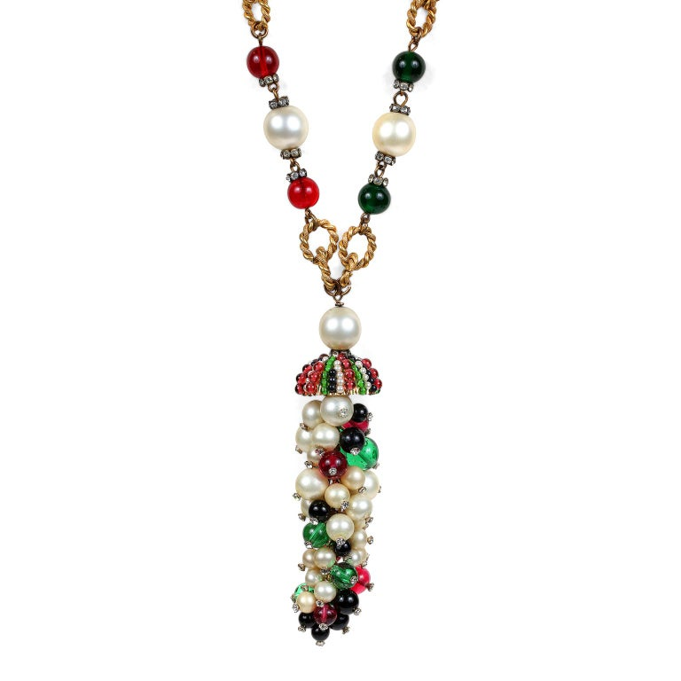This authentic Chanel Gripoix and Pearl Domed Pendant Necklace is in excellent vintage condition from the 1950's.  Red and green Gripoix glass beads and faux pearls are situated on a gold tone twisted link chain.  Stunning domed pendant cluster of