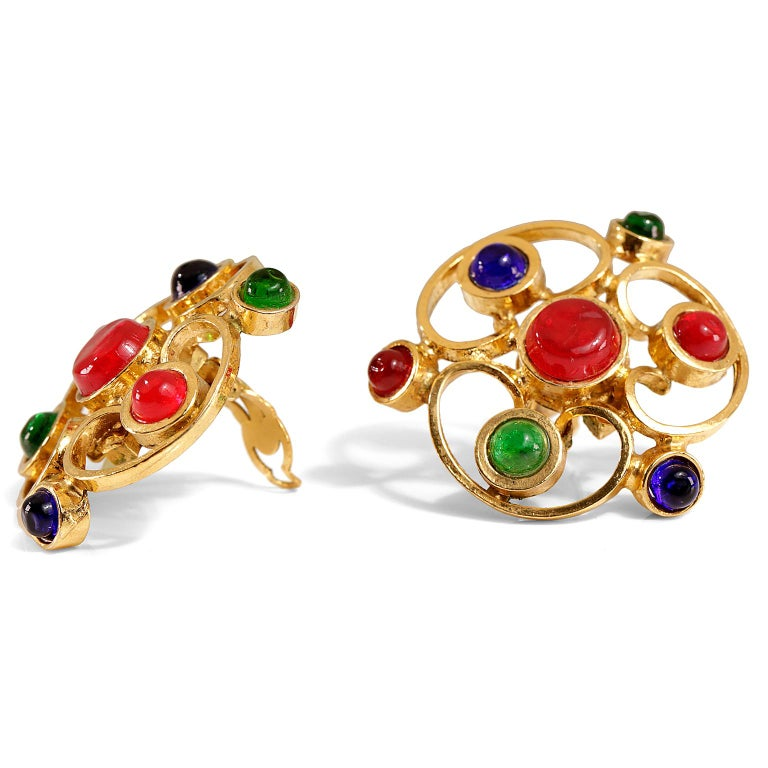 Chanel Gripoix Floral Spiral Clip On Earrings- mint condition Red, green and blue Gripoix stones are arranged in a gold spiral cutout flower large earring.  Clip on closure.