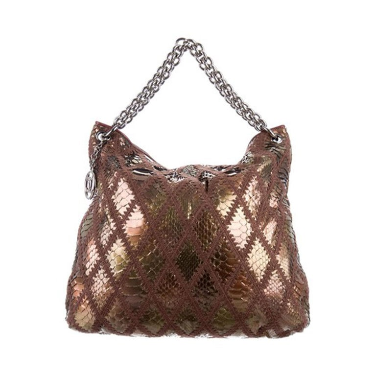 Chanel Rare Exotic Python Metallic Bronze Large 2 in 1  Tote & Clutch  2006 {VINTAGE 14 Years}  Silver hardware Metallic bronze python  Diamond stitch brown crochet   Thick chain handle Magnetic snap closure  Lambskin leather at interior top Satin