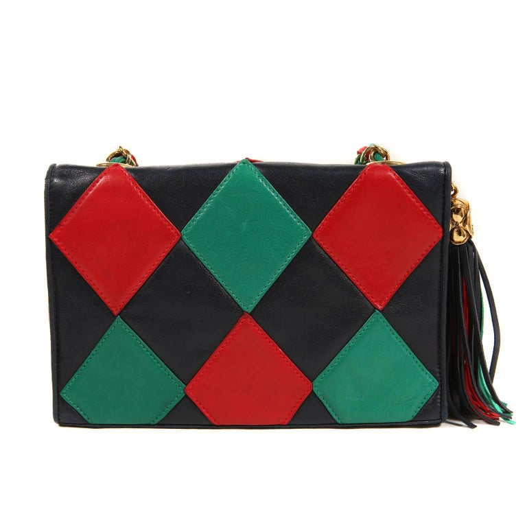 Chanel Harlequin Flap Bag- Mint Vintage Condition A very collectible piece, it has some truly unique design elements that are rarely seen. Navy leather rectangular flap bag has green and red harlequin diamond print.  An oversized leather tassel