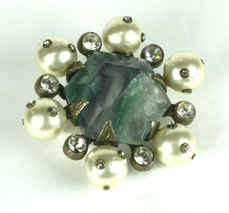 Chanel Haute Couture hexagonal cut natural fluorite crystal with faux pearls and crystals.  Crest brooch of hammered, darkened silver metal, bezel set crystals, the round faux pearls studded with smaller crystals.  Made as a sample and given to a