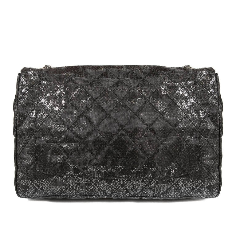 Chanel Hidden Sequins Jumbo Classic Flap Bag- Pristine, Unworn Condition. Special Edition. The classic silhouette is texturally and visually unique; an imperative acquisition for collectors.  Black mesh fabric is quilted in signature Chanel diamond
