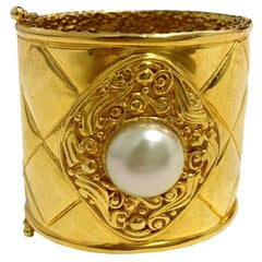 CHANEL Iconic 90's Cuff Bracelet in Gold Plated Metal and Pearl