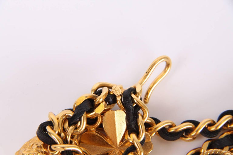 Vintage Chanel chain which can be worn as a belt, but also as a necklace.  This gold-tone chain measures 95 centimeters and holds as much as 21 charms which represent the iconic fashion brand: a four-leaf clover, Leo the Lion, lucky star, 5, Coco