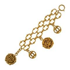 Chanel iconic gold tone cc logo charms bracelet