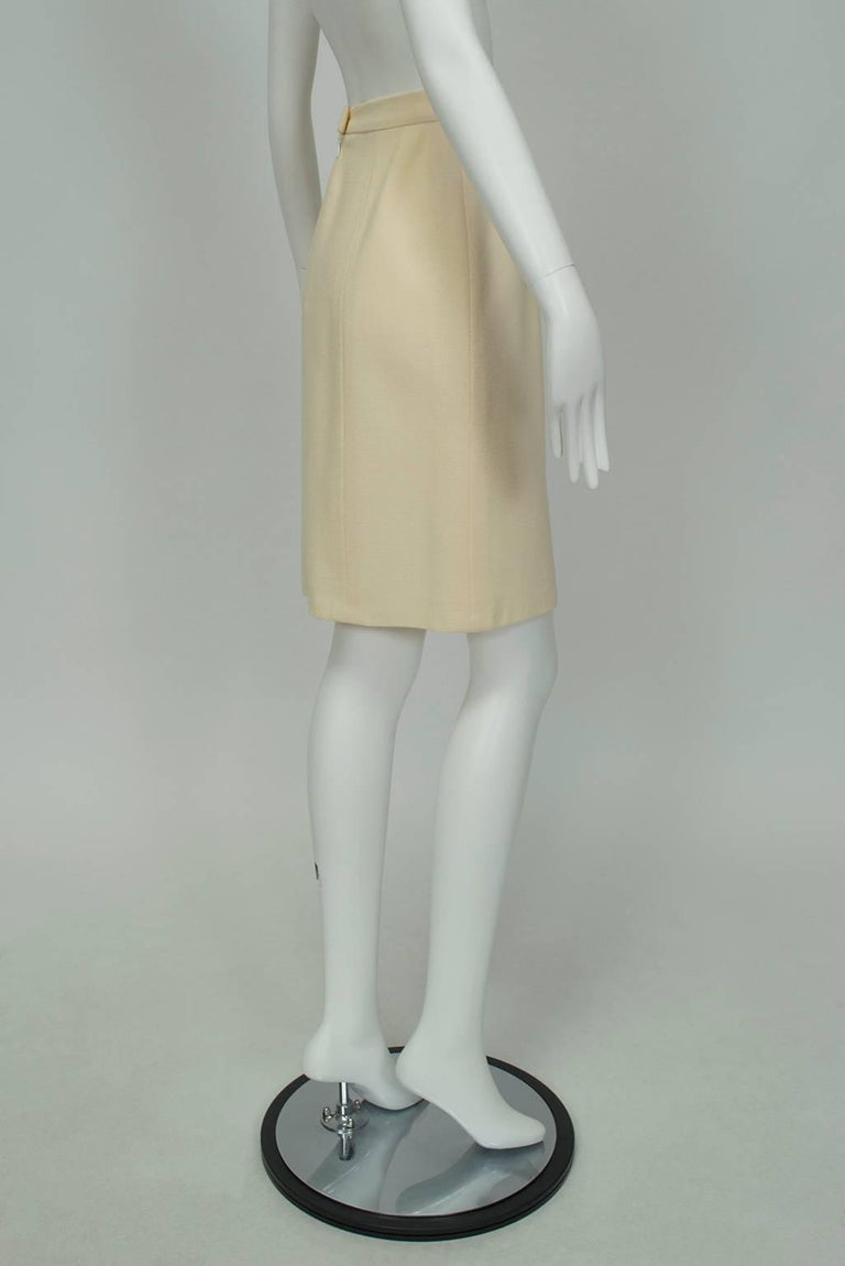 """A go-with-everything wardrobe work horse in gently textured wool. Shapely enough to be sexy while still permitting a comfortable stride.  Ivory 7-panel skirt of lightly textured wool; 1 ¼"""" plain waistband and gentle A-line shape. Hidden zipper"""
