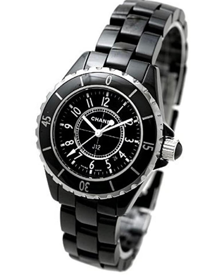 Chanel, Paris, J12 Automatic  200M.  Black dial enhanced by luminous hands. Black ceramic case with a black ceramic band. Automatic movement. 200 meters / 660 feet water resistance. Uni-directional Rotating bezel. Scratch Resistant Sapphire crystal.