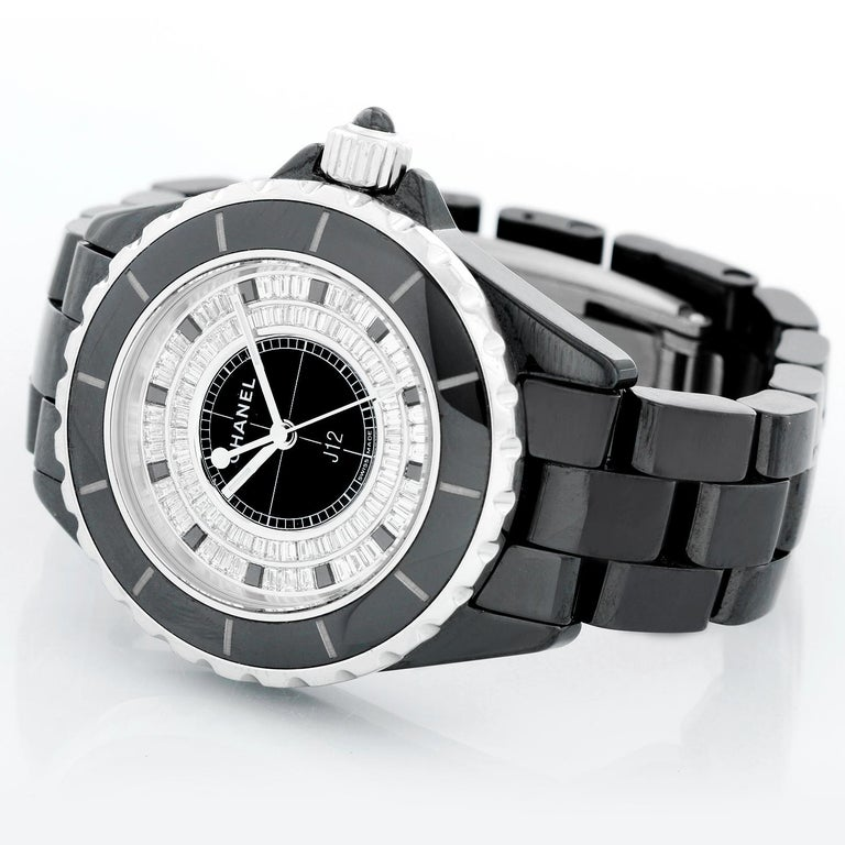 Chanel J12 Black Ceramic Diamond Watch - Automatic winding. Black ceramic case (33 mm). 84 baguette-cut FG-VVS1 diamonds ( 2 cts. ). Black ceramic bracelet with deployant clasp; wrist size up to 5 3/4. Pre-owned with custom box. Limited to 55.
