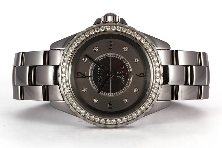 We are pleased to offer this Authentic Chanel J12 Chromatic Ceramic Watch H2566. This watch features a8mm titanium ceramic case, diamond bezel, titanium dial with 8 diamond hour markers, automatic winding movement, and a titanium ceramic bracelet.