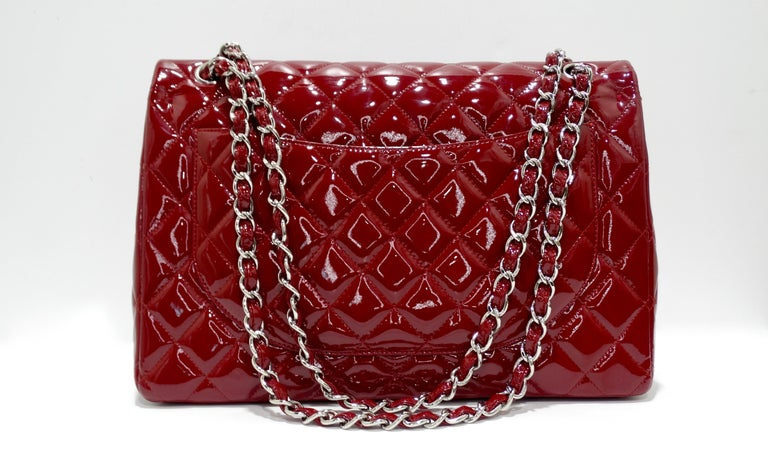 Feel red hot with this stunning red Chanel patent jumbo double flap! Featuring a beautiful red patent leather with silver hardware and a silver chain strap that can be worn cross body or doubled up to be a shoulder bag. Features leather