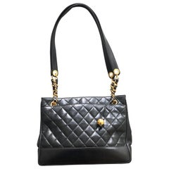 Chanel Large Black Leather Shoulder Bag with Gold Hardware and Quilted Details