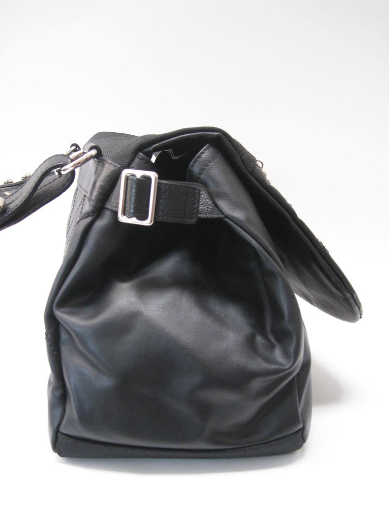Chanel large black hobo bag.  Sturdy structured leather construction.  Bottom and part of front flap are made of a textured canvas.  Silver hardware throughout. Lampo zippers.  Adjustable side buckles.  Quilted flap and back.  Padded shoulder strap