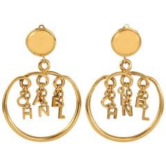Chanel Letter Charm Hoop Earrings