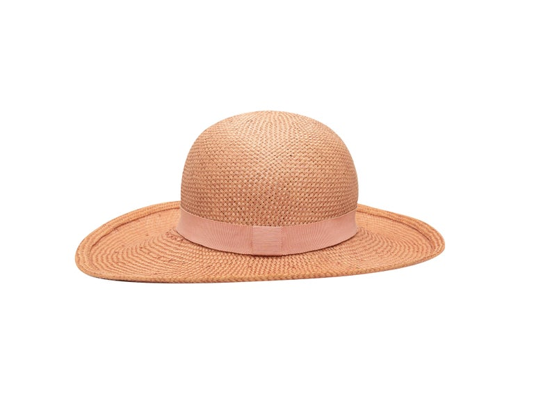 Product details: Vintage light pink straw hat by Chanel. Tonal ribbon trim. Designer size 58. 5