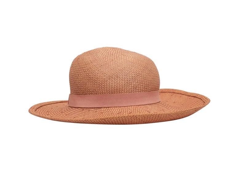 Product details: Vintage light pink straw hat by Chanel. Tonal ribbon trim. Designer size 58. 5