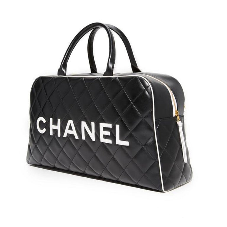 Women's or Men's Chanel Limited Edition Vintage Duffel Tote Black and White Leather Weekend Bag For Sale